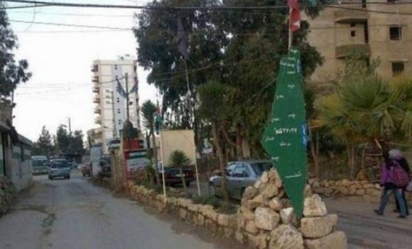 الصليب الأحمر يوزع مواد تعقيم على أهالي مخيم البداوي