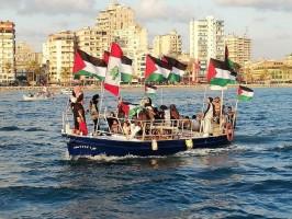بالصور و الفيديو - تنظيم مسيرة بحرية رمزية في صور رفضا للتطبيع